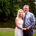 Bride holds father before the Wedding Ceremony and smiles at camera by Lake in Lebanon OH