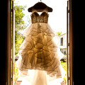 Ruffle Wedding Dress Gown hung in a doorway showing the curves of the tulle at Lost Creek Memory Barn in OH