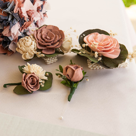 Paper flowers for boutonnieres in pinks