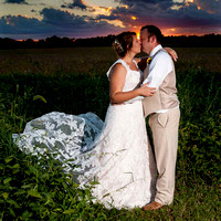 kissing at sunset as husband and wife