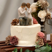 delicate buttercream cake and wooden topper